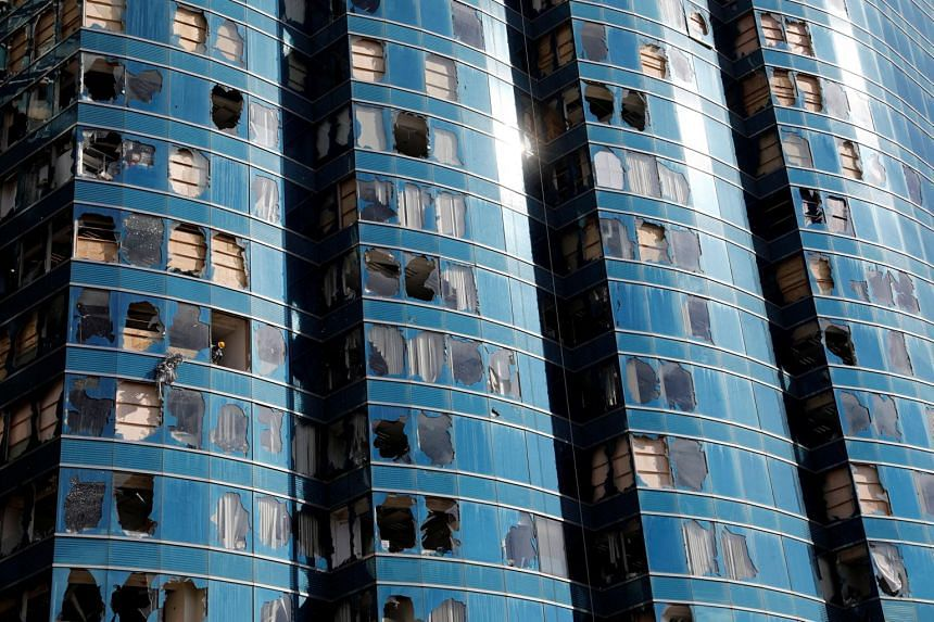 Damaged windows of the One HarbourFront office tower are seen after Super Typhoon Mangkhut hit Hong Kong, China, on Sept 18, 2018.