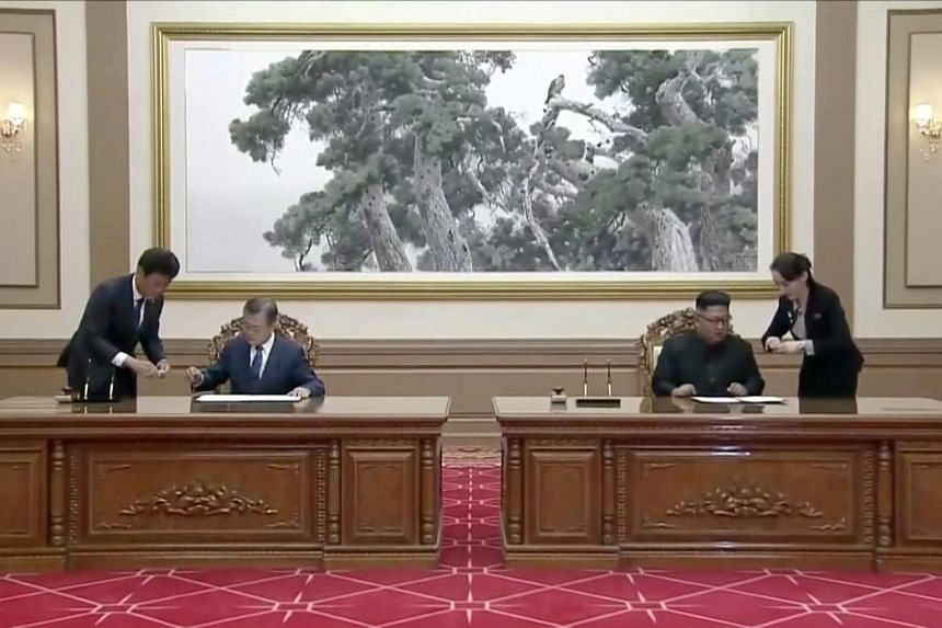 South Korean President Moon Jae-in (left) and North Korean leader Kim Jong Un sign documents during the inter-Korean summit at the Paekhwawon State Guesthouse in Pyongyang, on Sept 19, 2018.