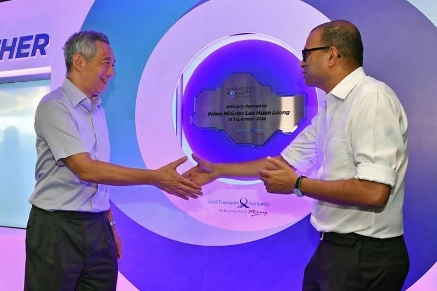 Prime Minister Lee Hsien Loong (left) and Senior Minister of State for Transport Dr Janil Puthucheary at the launch of the SG Mobility Gallery.