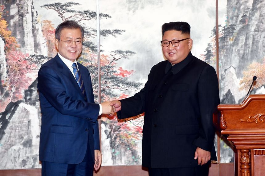 South Korean president Moon Jae-in (left) shakes hands with North Korean leader Kim Jong Un during a joint news conference in Pyongyang, North Korea, on Sept 19, 2018.