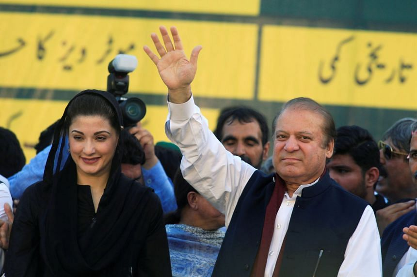 Nawaz Sharif (right), former Prime Minister and leader of Pakistan Muslim League, and his daughter Maryam Nawaz at the party's workers convention in Islamabad, Pakistan, on June 4, 2018.