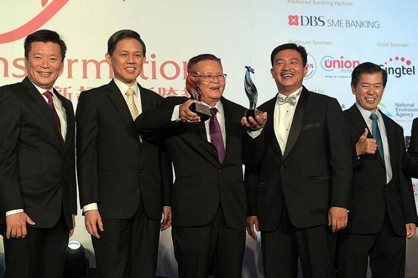 At Tuesday (Sept 18) night's Singapore Heartland Enterprise Star Awards were (from left) Mr Goh Sin Teck, editor of Lianhe Zaobao and Lianhe Wanbao; Minister for Trade and Industry Chan Chun Sing; Poh Cheu Kitchen founder Neo Poh Cheu, the overall aw