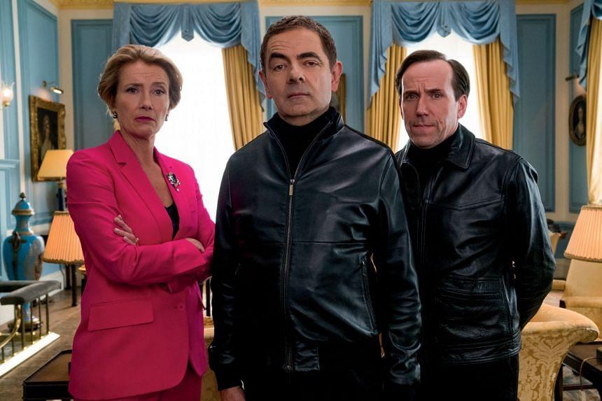 Rowan Atkinson (centre) in Johnny English Strikes Again.