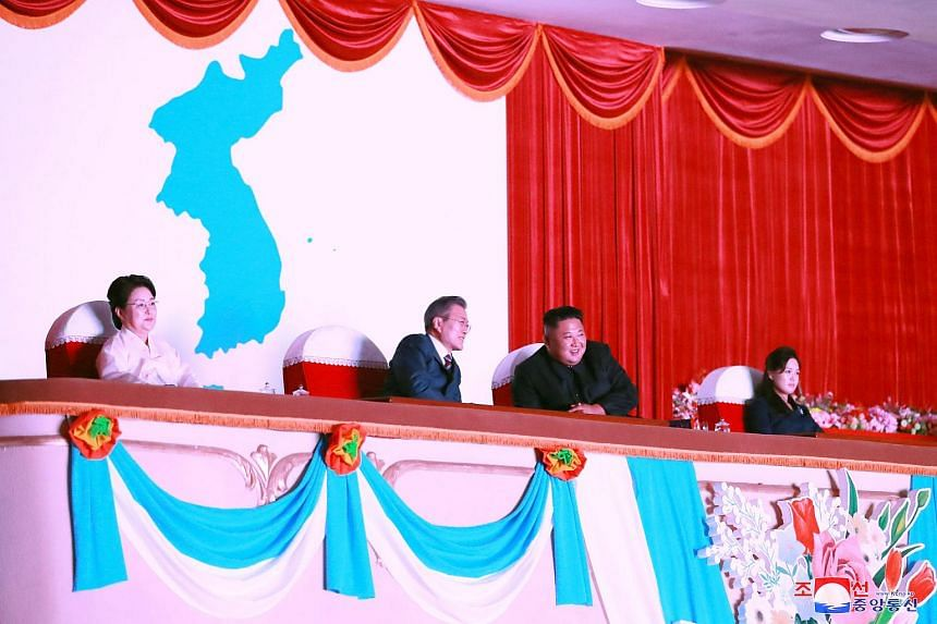 South Korean President Moon Jae-in (second left) talks with North Korean leader Kim Jong Un (second right) as they watch an arts performance at Pyongyang Grand Theatre in Pyongyang.