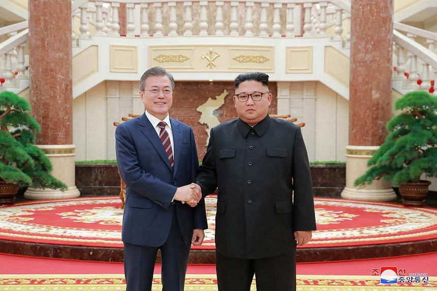 """South Korean President Moon Jae-in (left) and North Korean leader Kim Jong Un kicked off their third meeting on Sept 18, during which Kim said his """"historic"""" summit with US President Donald Trump in June had improved regional stability and raised hop"""