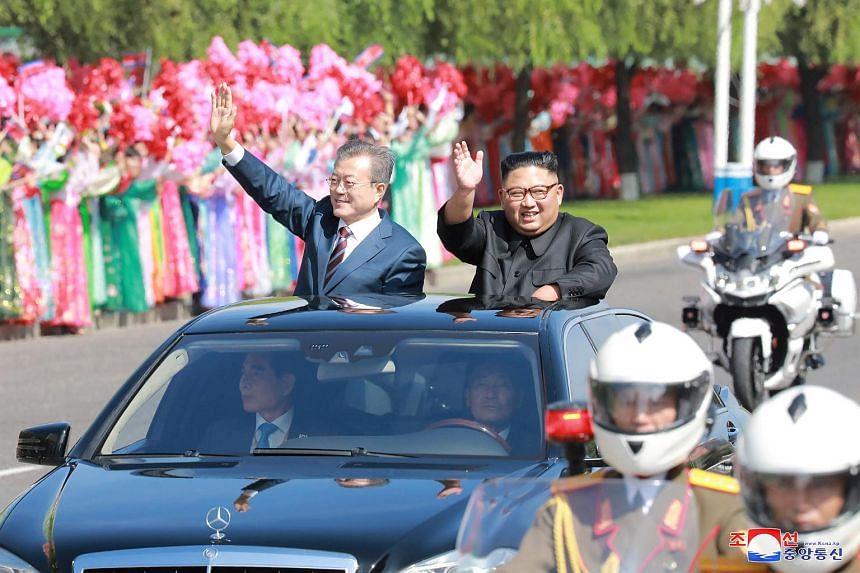 South Korean President Moon Jae-in and North Korean leader Kim Jong Un during a car parade in Pyongyang, North Korea.