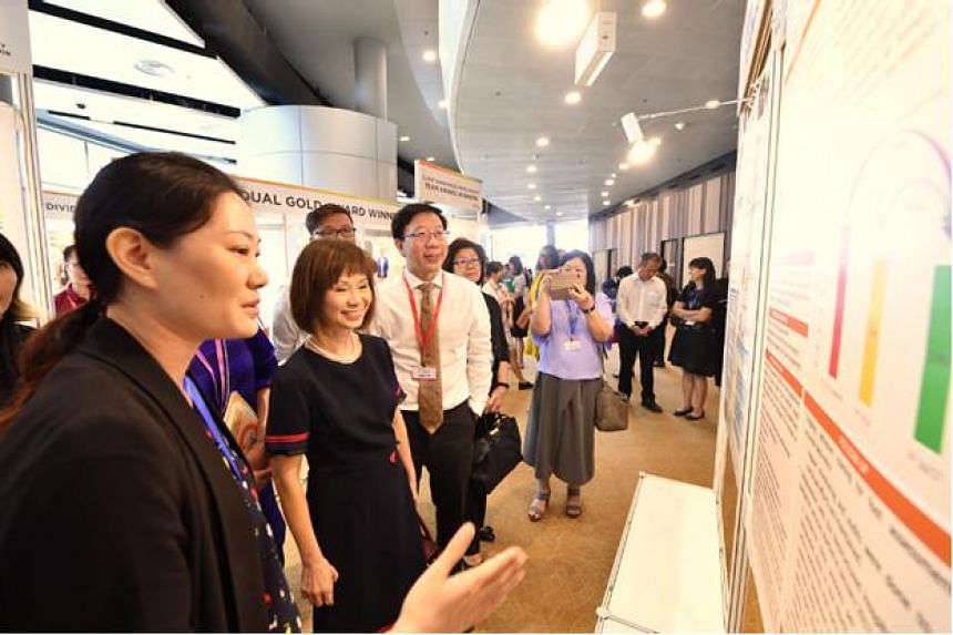 Senior Minister of State for Heath Amy Khor  touring the poster exhibitions at the Quality and Productivity Festival 2018 on Sept 19, 2018.