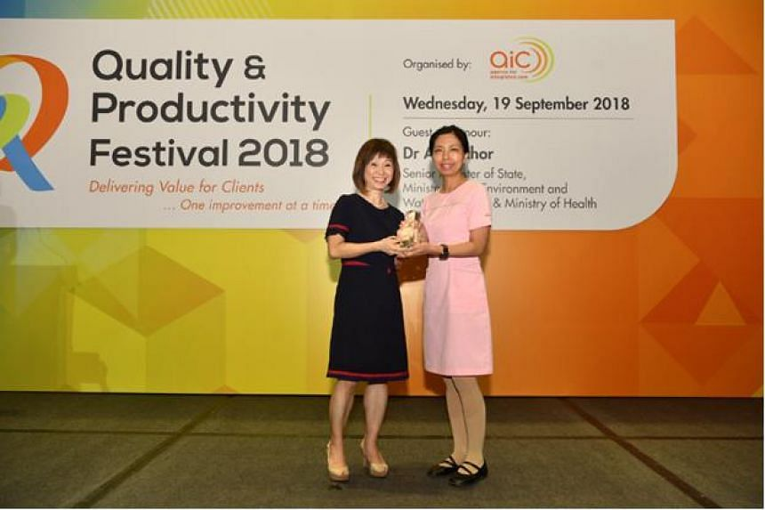 Senior Minister of State for Heath Amy Khor presenting the Community Care Excellence Awards to one of the winners at the Quality and Productivity Festival 2018 on Sept 19, 2018.