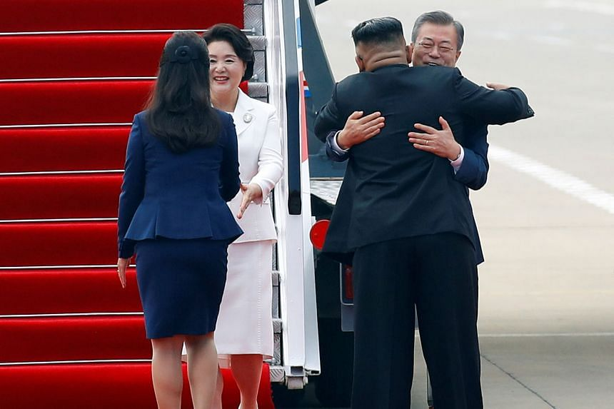 South Korean President Moon Jae-in and his wife Kim Jung-sook being greeted by North Korean leader Kim Jong Un and his wife Ri Sol Ju at Pyongyang Sunan International Airport yesterday. Mr Kim thanked the South Korean President for bringing about the