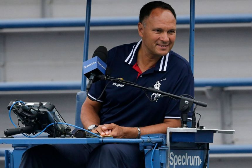 Umpire Mohamed Lahyani watches over a doubles match at the 2018 US Open in August 2018.