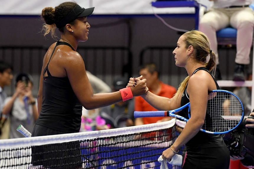 Naomi Osaka (left) is congratulated by Dominika Cibulkova after their women's singles second round match at the Pan Pacific Open tennis tournament in Tokyo, on Sept 19, 2018.