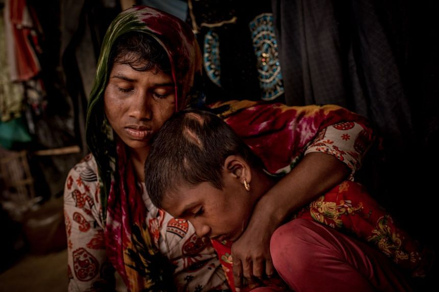 A Rohingya mother and her daughter, who fled the village of Min Gyi in Myanmar, at a refugee camp near in Bangladesh in 2017.