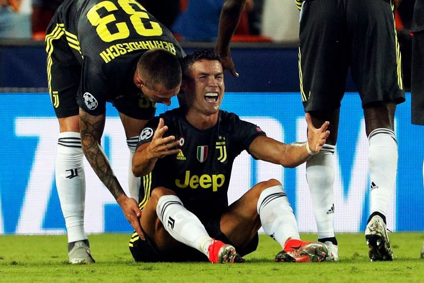 Juventus' forward Cristiano Ronaldo reacts after being sent off.