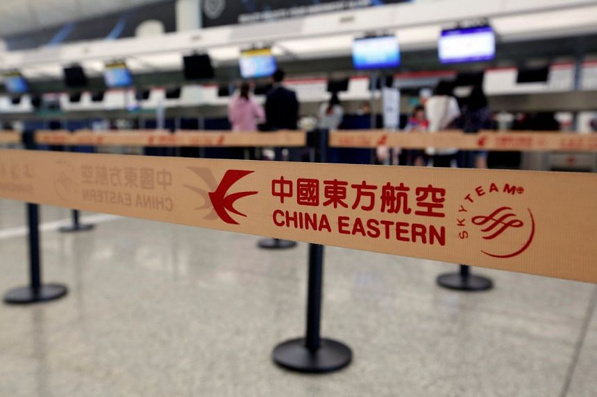 Passengers check in with China Eastern Airlines at the Hong Kong Airport in Hong Kong, on April 4, 2018.