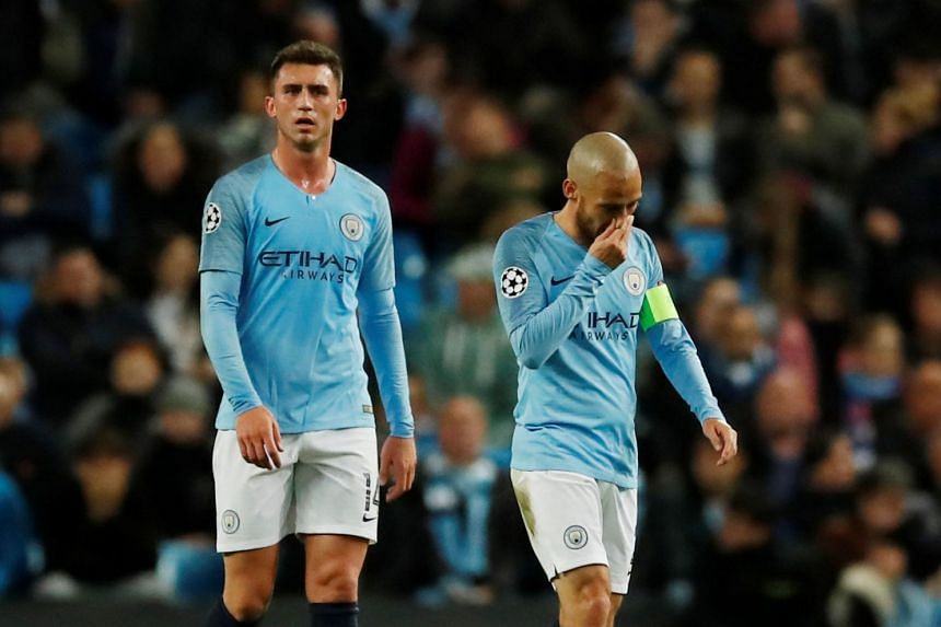 Manchester City's Aymeric Laporte and David Silva look dejected after Lyon's second goal.