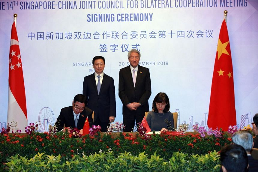 Singapore's National Arts Council CEO Rosa Daniel and China's Ministry of Culture and Tourism party leadership group member Du Jiang signing a memorandum of understanding for a partnership between NAC and the China National Arts Fund to promote excha