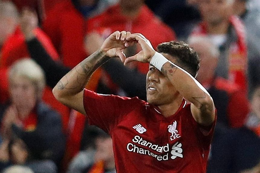 Roberto Firmino showing his love for the Anfield faithful after scoring Liverpool's winner at the death against PSG on Tuesday night in the Champions League.