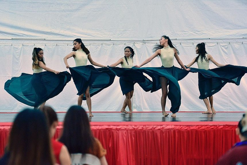 Dance students from Lasalle College of the Arts performing a routine called Sacred Connection at Ngee Ann City's Civic Plaza yesterday. They were among several local dance groups to take the stage as part of Music-In-The-City, a monthly showcase of y