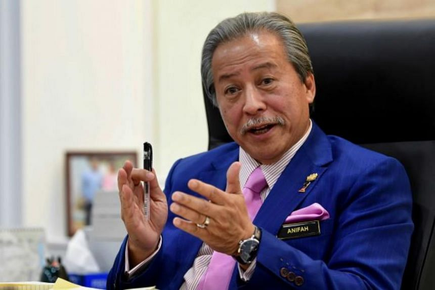 Datuk Seri Anifah Aman's (above) resignation came less than 24 hours of Datuk Seri Mustapa Mohamed's departure from Umno.