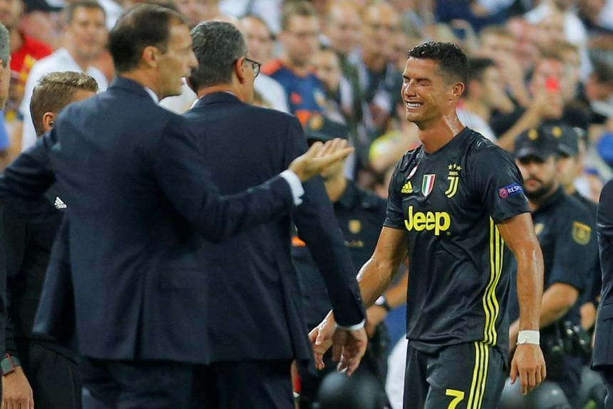 Juventus' Cristiano Ronaldo reacts to being sent off after being red-carded during the Champions League match with Valencia.