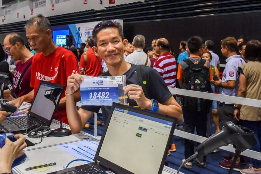 Mr Ho Chor Yin, 47, a facilities manager, was the first person to collect his race pack. This will be his fifth ST Run this year.