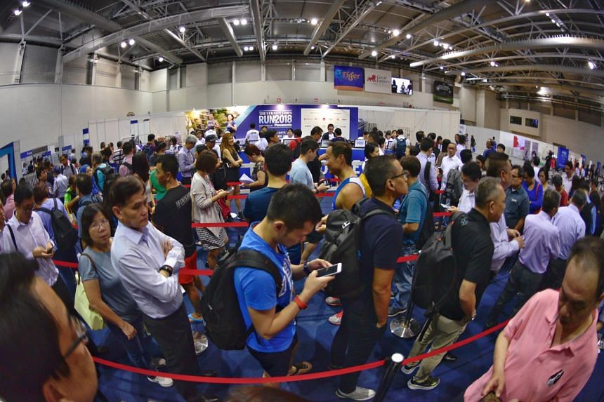 ST Run participants queueing to collect their race packs during the ST Run Festival at the OCBC Arena on Sept 20, 2018.