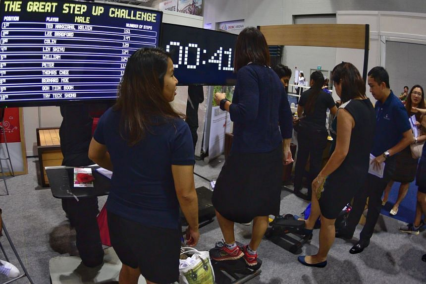 People taking part in The Great Step Up Challenge during the ST Run festival at the OCBC Arena on Sept 20, 2018.