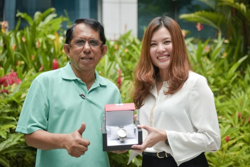 Hajamohideen, 64, (left) was presented with his Tissot watch by Tissot Singapore vice-president Mok Pei San on Sept 20, 2018.