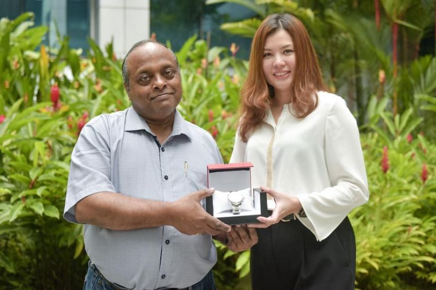 Basil Lopez, 60, (left) was presented with his Tissot watch by Tissot Singapore vice-president Mok Pei San on Sept 20, 2018.