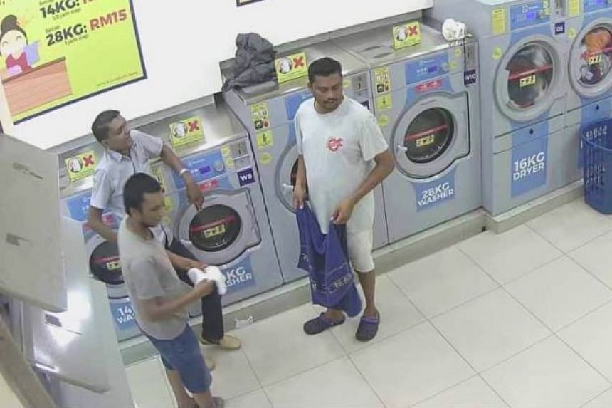 A CCTV recording shows the two men with a third person, who is still at large, putting the cat in the dryer before turning the machine on.