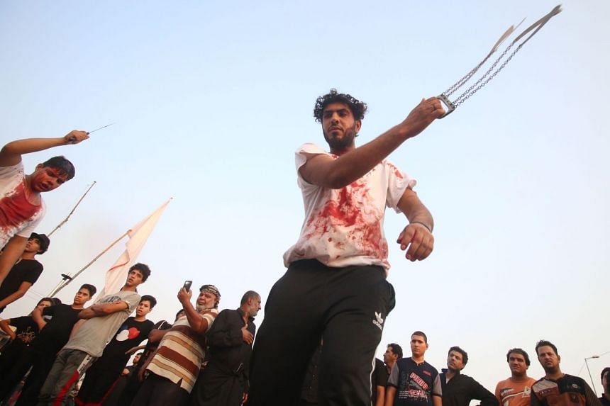 A Shi'ite Muslim flagellating himself to mark Ashura, a festival commemorating the death of Imam Hussein, in Basra, Iraq, on Sept 20, 2018.