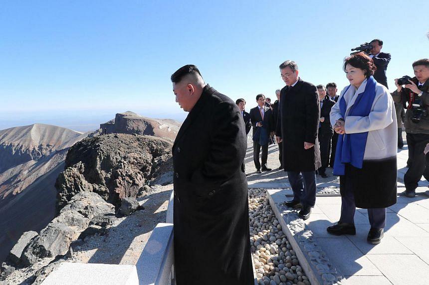 (From left) North Korean leader Kim Jong Un, South Korean president Moon Jae-in, South Korean first lady Kim Jung-sook and North Korean first lady Ri Sol Ju visit Mount Baekdu, North Korea, on Sept 20 2018.