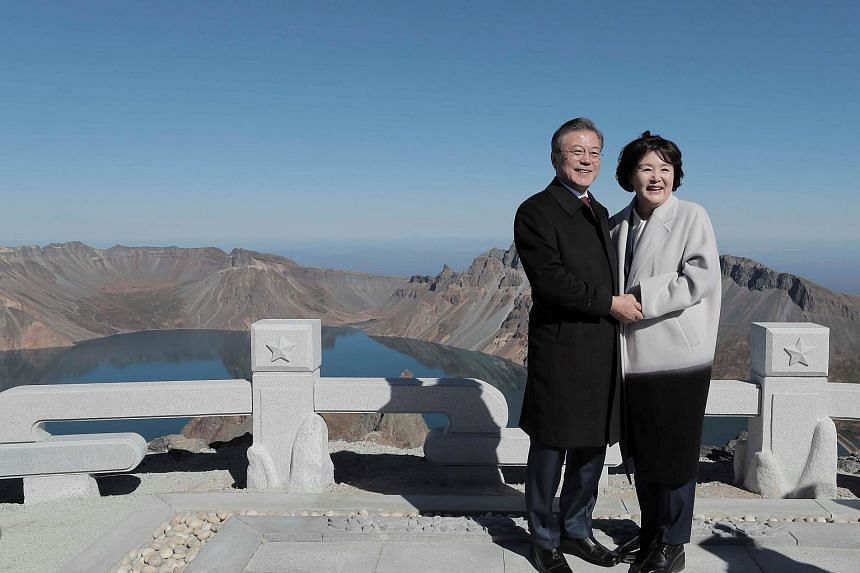 South Korean President Moon Jae-in and first lady Kim Jung-sook pose for photographs on the top of Mount Baekdu, North Korea, on Sept 20, 2018.