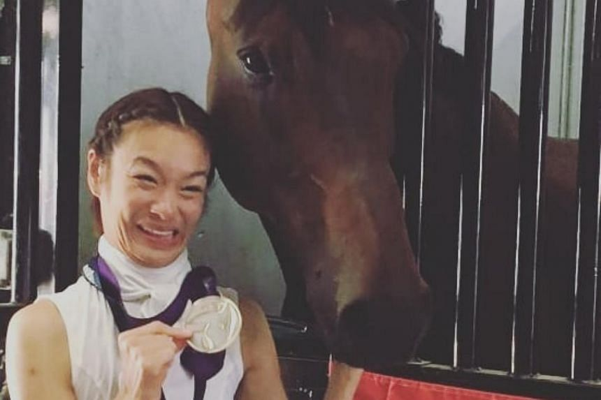 Riding on Fuerst Sherlock, Laurentia Tan (pictured) scored 73.750 per cent to place second, behind Italy's Sara Morganti (74.750 per cent).