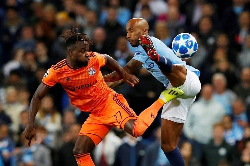 Olympique Lyonnais' Maxwel Cornet in action with Manchester City's Fabian Delph during the Champions League Group F game on Sept 19, 2018.