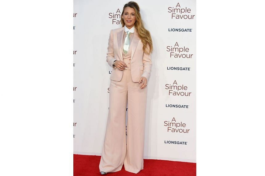 "It suits her to a T, said actress Blake Lively, defending her choice of a suit to promote her latest movie, A Simple Favour, at its British premiere in London on Monday. Responding to snide comments over her fashion picks, she wrote on Instagram: ""Wo"