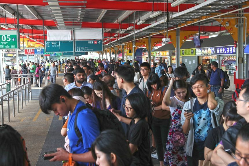 SMRT staff at work on the tracks after a glitch affected a switch that allows trains to change tracks. SMRT said East-West Line trains at Jurong East and Clementi stations had to halt temporarily for up to five minutes every time engineering staff we