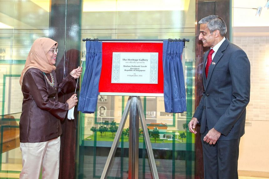 President Halimah Yacob opening a new heritage gallery that documents historic moments in the ties between the two countries at the Singapore High Commission in Kuala Lumpur yesterday. Beside her is Singapore's High Commissioner to Malaysia Vanu Gopa