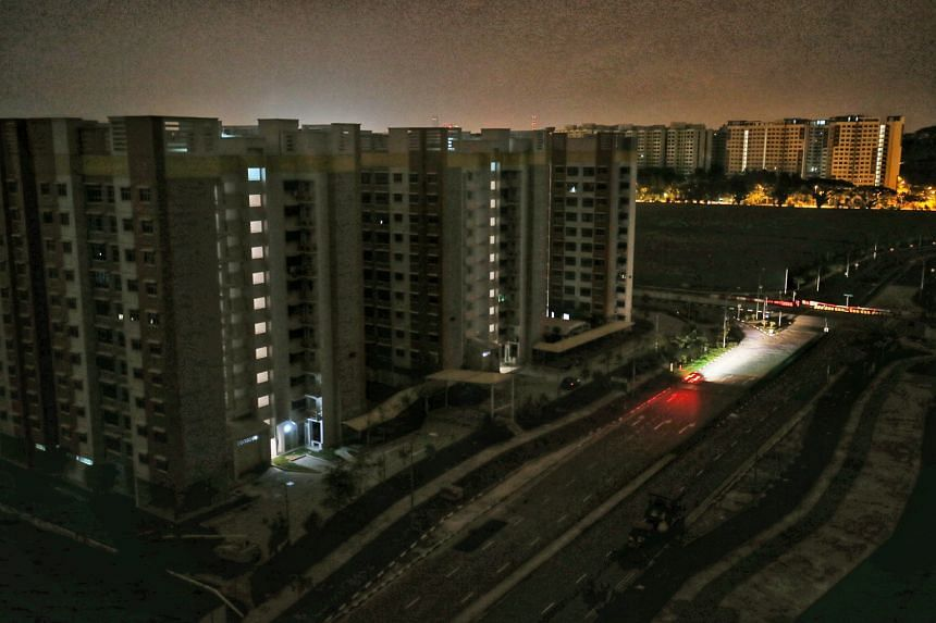Canberra Crescent in the Sembawang area was plunged into darkness early on Tuesday morning during the blackout that affected 19 areas in Singapore, including Bedok, Thomson, Mandai, Admiralty and Woodlands. Residents gathered at the void decks until