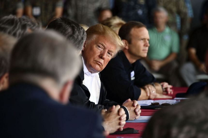 Trump listening at Marine Corps Air Station Cherry Point, after his arrival in North Carolina.