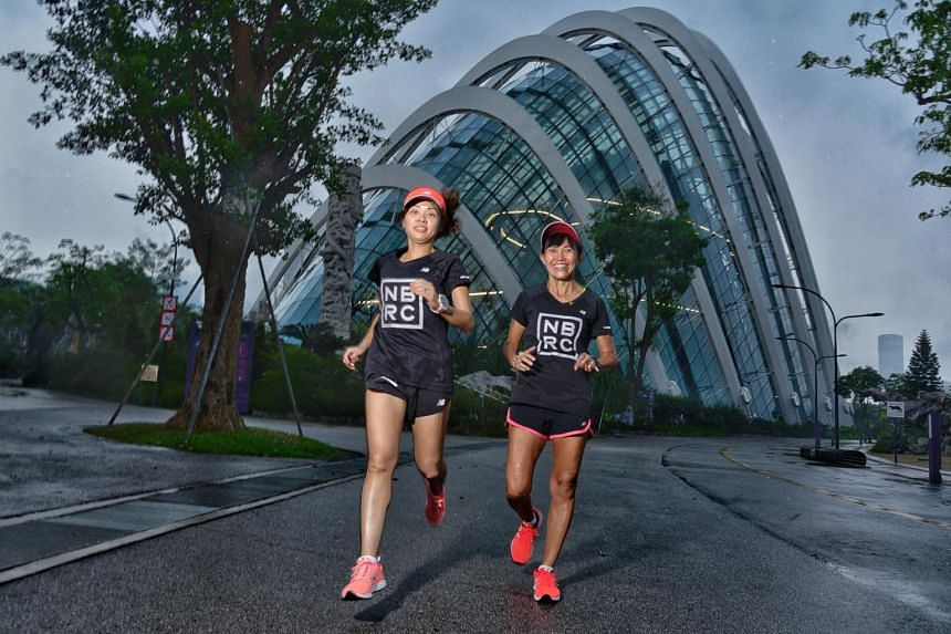 Carol Goh (left) and Connie Liang jog along the ST Run route outside the Flower Dome.