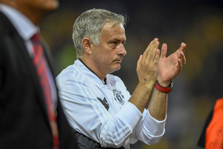 Mourinho applauding after United's Champions League group match against BSC Young Boys, in Bern, Switzerland.