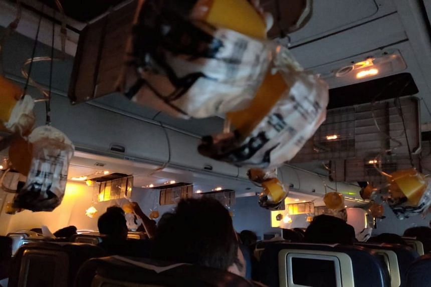 Oxygen masks are seen deployed after a loss of cabin pressure on a Jet Airways flight from Mumbai.