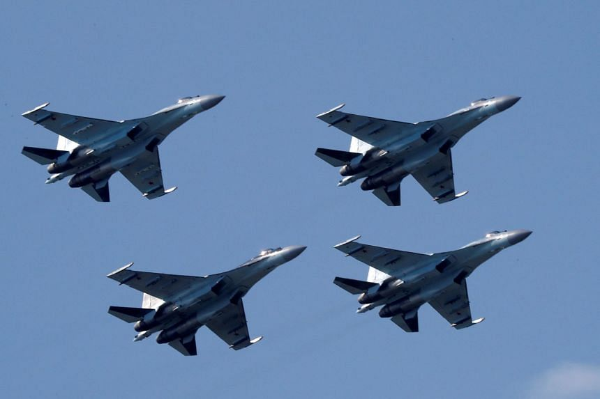 Sukhoi Su-35 fighter jets fly in formation during a demonstration at the MAKS 2017 air show outside Moscow.