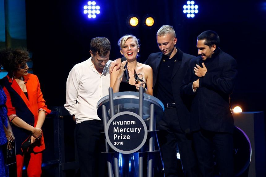 Members of the band Wolf Alice speak onstage after being announced winners.