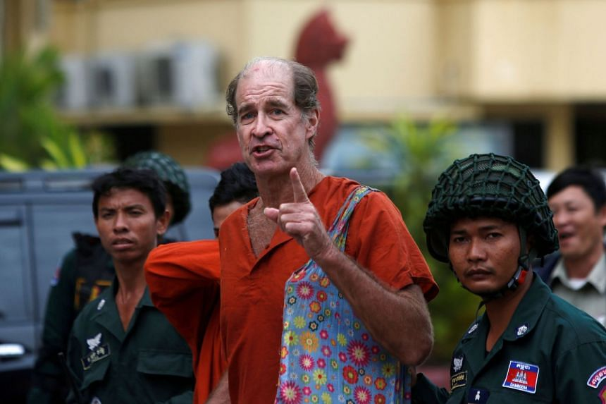 Australia filmmaker James Ricketson (centre) speaks to the media at the Supreme Court in Phnom Penh, Cambodia, on Jan 17, 2018.