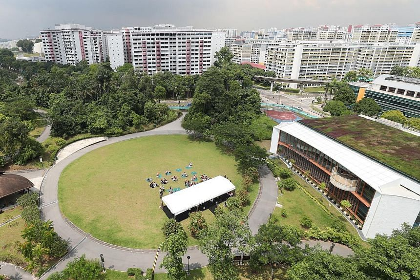 An aerial view of NTUC First Campus' My First Skool in Segar Road (far right), which is situated within Zhenghua Nature Park. The 3,000 sq m centre can take in 400 children.
