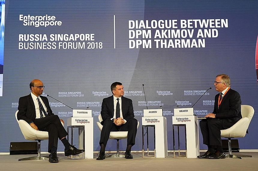 (From left) Deputy Prime Minister Tharman Shanmugaratnam, Russian Deputy Prime Minister Maxim Akimov and moderator Christopher Weafer, senior partner and founder at Macro Advisory, during yesterday's dialogue at the 13th Russia-Singapore Business For