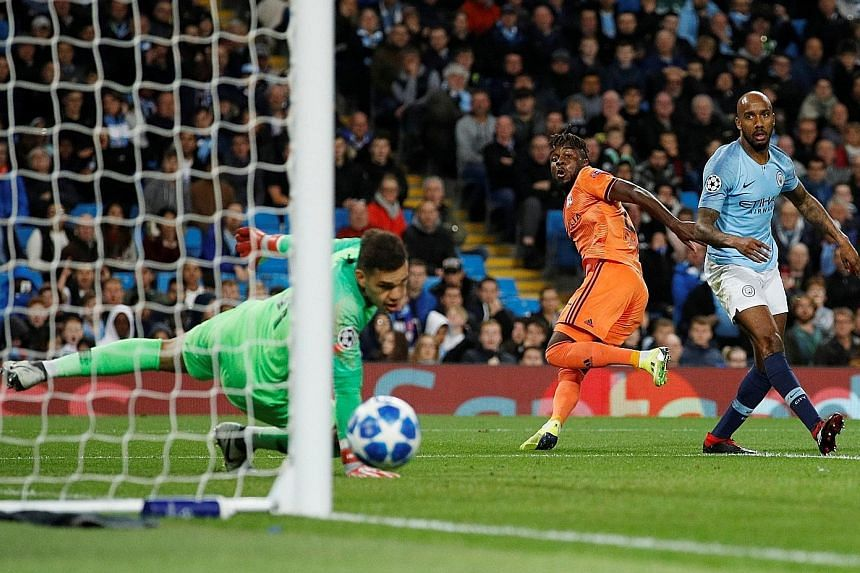 Lyon forward Maxwel Cornet (in orange) wheeling away in delight after opening the scoring for the French Ligue 1 team against Manchester City in their Champions League Group F opener at the Etihad Stadium on Wednesday.