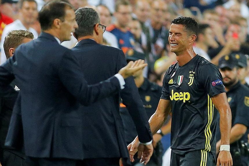 Juventus' Cristiano Ronaldo leaving the pitch in tears after a red card for an off-the-ball incident involving Valencia defender Jeison Murillo. The forward, who had never been sent off in 153 Champions League games before Wednesday, will miss the ne